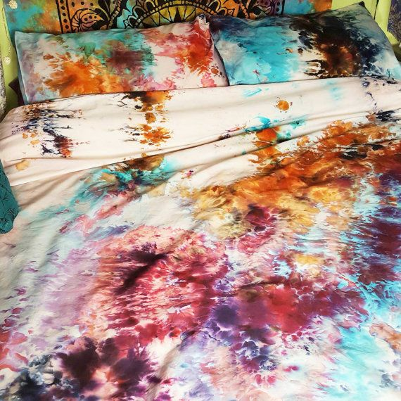 Hand dyed ice tie dye duvet cover and 2 pillow cases. 100% Eygptian cotton, 400 thread count. Sizes- Single/Twin: 135cm x 198cm, Double/Full: 198cm x 198cm, King/Queen: 230cm x 218cm, Super King/King: 260cm x 218cm. 1 pillowcase with single/twin, 2 pillowcases with all other sizes. I like to think of these bed sheets as little works of art, all are unique and vary. Due to the nature of ice dying, the patterns created will be unique to each duvet cover. Each one is made to order so please…
