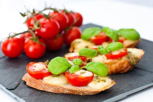 Tomato Mozzarella Pesto Crostini