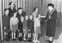Children raise £ 125 in pennies for prisoners of war. The mayoress receiving cheque at Prahran Town Hall, ca. 1942.