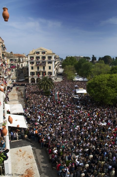 Greek Easter in Corfu - GREECE  With the first sign of the Resurrection on Holly Saturday at 11 am, residents of Corfu fly huge jugs full of water (botides) - from their balconies.