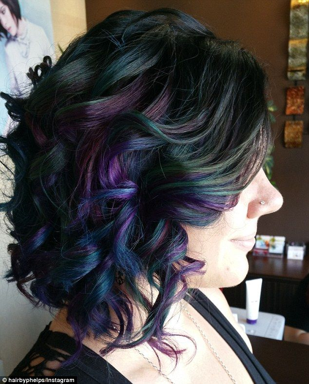 Unlike with pastel shades, the deeper colours used to create the oil slick effect don't fade so quickly. Pictured, an example created by Michelle Phelps at Picasso hair design