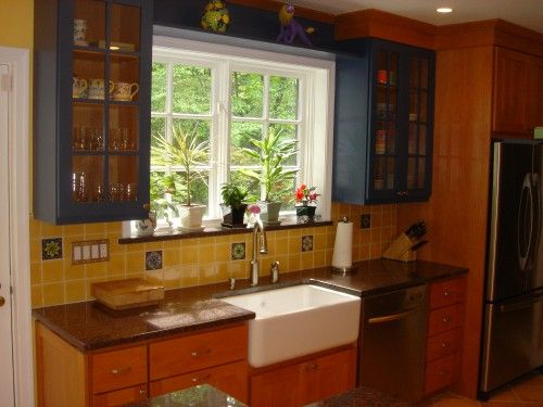 This Spanish style inspired kitchen by Case Design integrates two ...