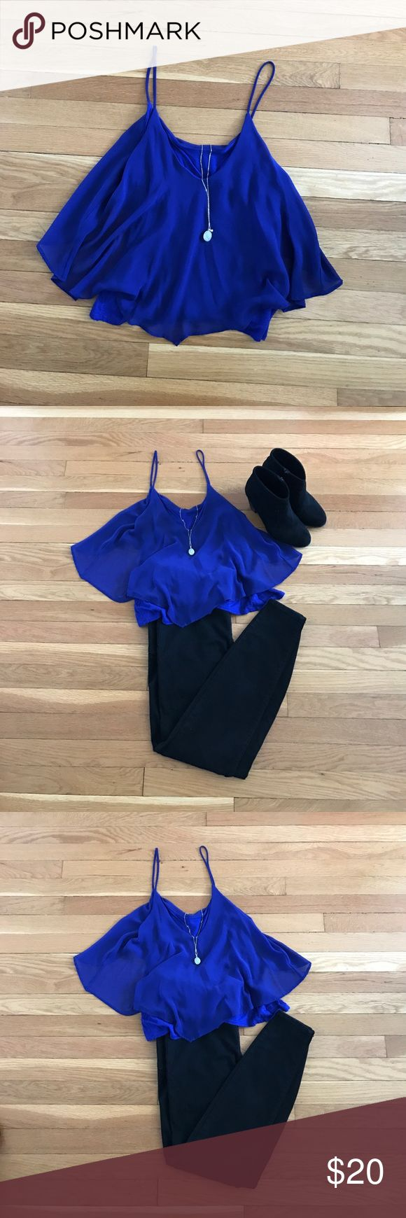 Flirty Blue Urban Outfitters Tank Top This flowy blue Urban Outfitters tank top is great for a night out or a day around town. Pair with black jeans and booties for an evening look, or jeans and sandals for a daytime look. Urban Outfitters Tops Tank Tops