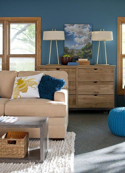 BHG article with tips on picking paint colors in rooms with wood trim.  Seems like every design site/mag/blog only shows white trim.