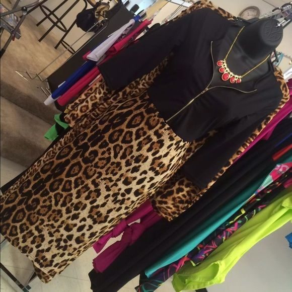 ⚡️SALE⚡️Black Zip Top bottom Leopard Dress. Black Zip Top bottom Leopard Dress. This dress tends to run small, & is designed to be form fitting and stretches for an always flattering look. If you have any question about the size, please contact me freely commenting or by text message (252)885-4120. THANK YOU! Dresses Midi