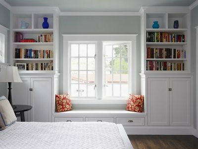 window seat and storage. Cabinet and shelf built ins.