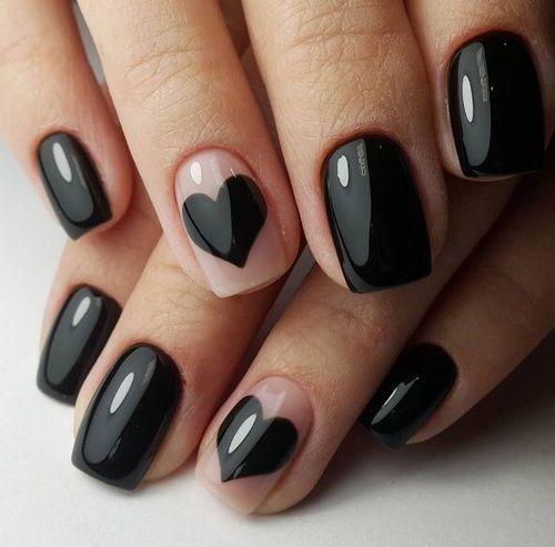 Black nails and heart accent nail. #nailart