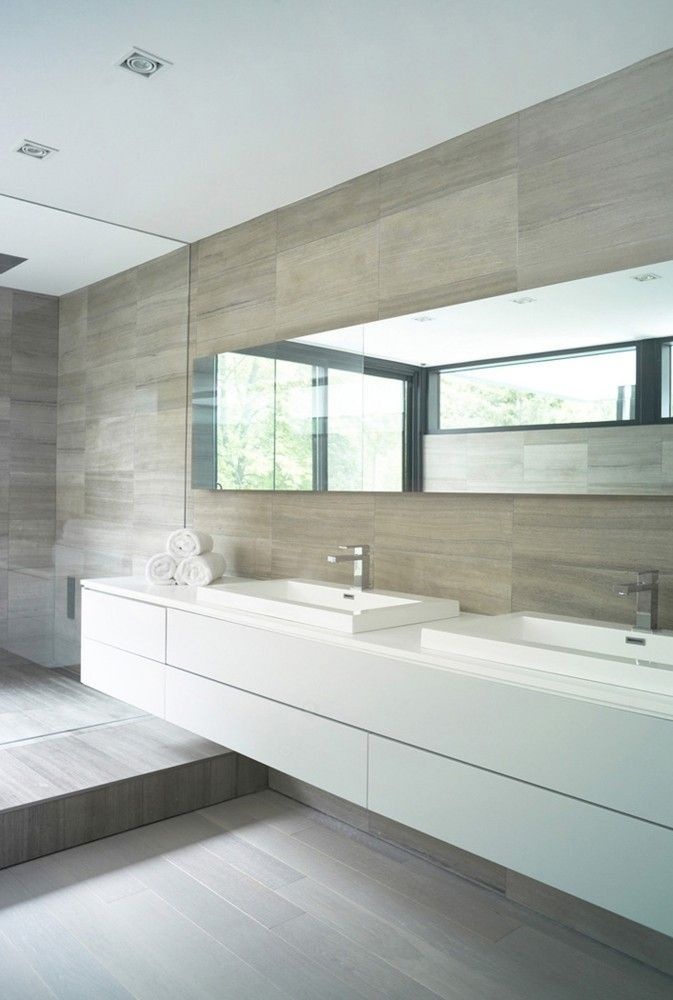 earthy tiles, big mirror and vanity, perfect family size