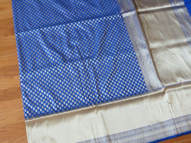 Look sensuous in this lustrous Royal Blue banarasi Dehera silk katan with all…