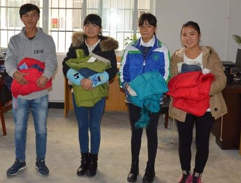 Anlong Students got new coats and pants.