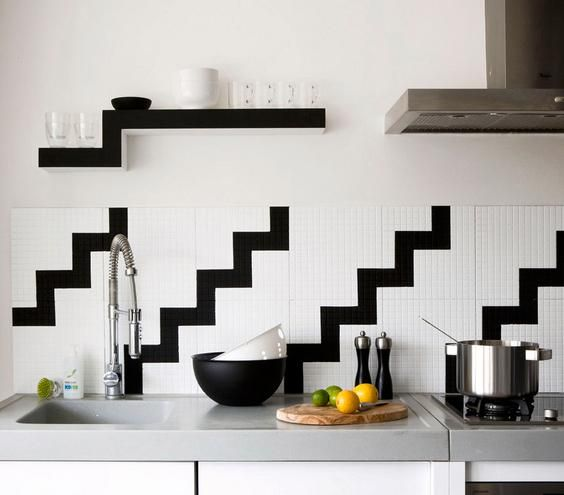 A continuous pattern, like this modern black-and-white zigzag, running across a counter or backsplash is graphic and unexpected.