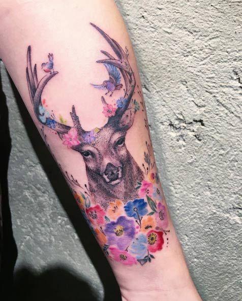 Floral deer tattoo by Eva Krbdk