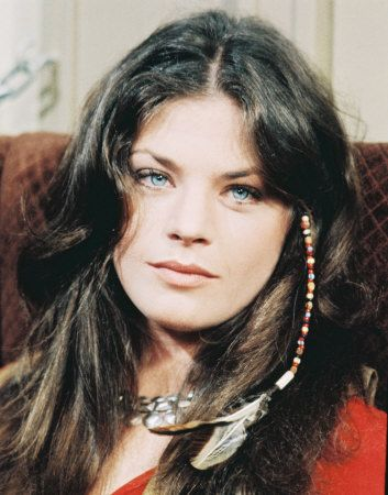 Meg Foster has eyes like my dad (and me and Tyce). I'm pinning this for the cool beaded feather in her hair though. I'm feeling it.