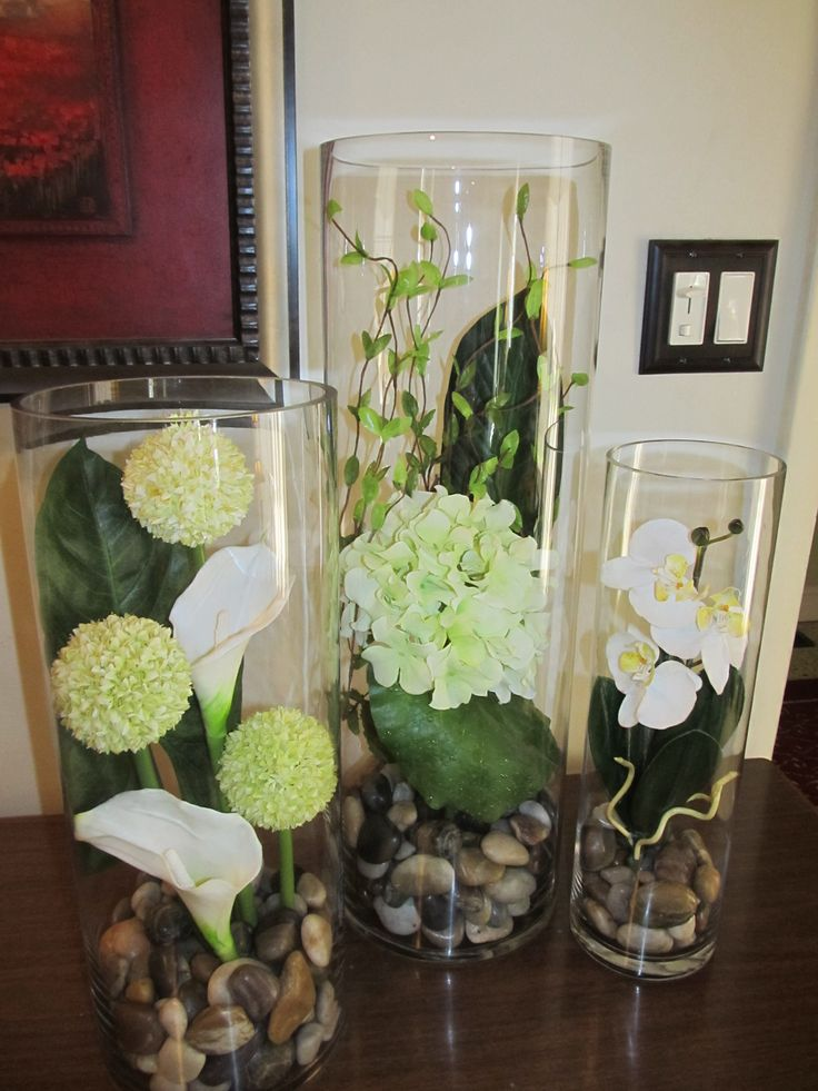 Tall cylinder vase set. Simple, but beautiful. Got this idea in Spain a few weeks ago & love it! Found the vases & flowers at Michaels. Stones were cheaper at Dollar Tree. Total cost, $79. It will look even better in spot I made it for, once our renovation is complete