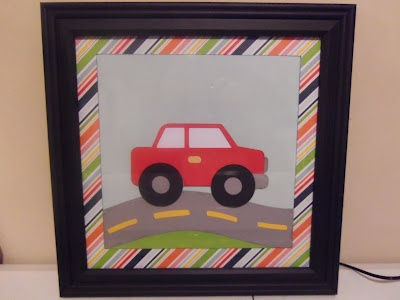 I found some black 10x10 frames at Michael's - they were on sale, so they ended up being less then $4 each! His quilt has a mix of construction vehicles and cars so I went through the Cricut carts that I have, to pick out some that looked similar. I used a car and dump truck from Boys Will Be Boys and a car as well as the roads from Everyday Paper Dolls.