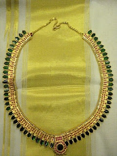 40 years old gold nagapadathali......almost alla Malayali woman have this type of one in her jwellery collection.