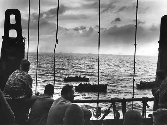 US Marines aboard a US Coast Guard-manned transport while they traveled for Tarawa Gilbert Islands November 1943.