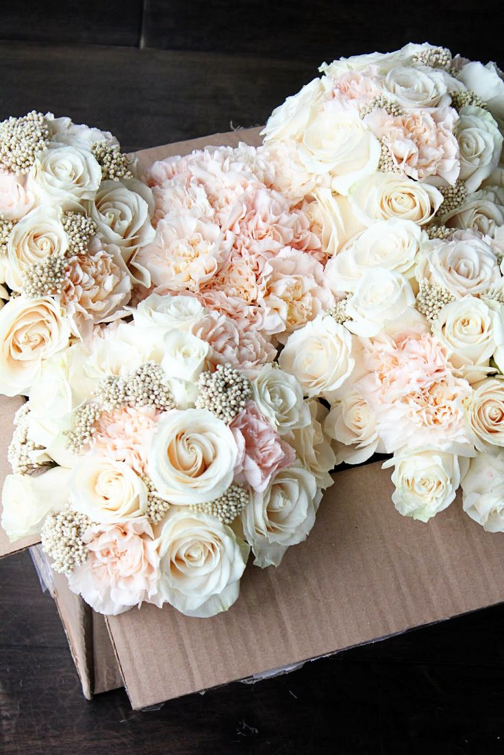 Blush bouquets of roses, carnations and rice flower. Beautiful colors.