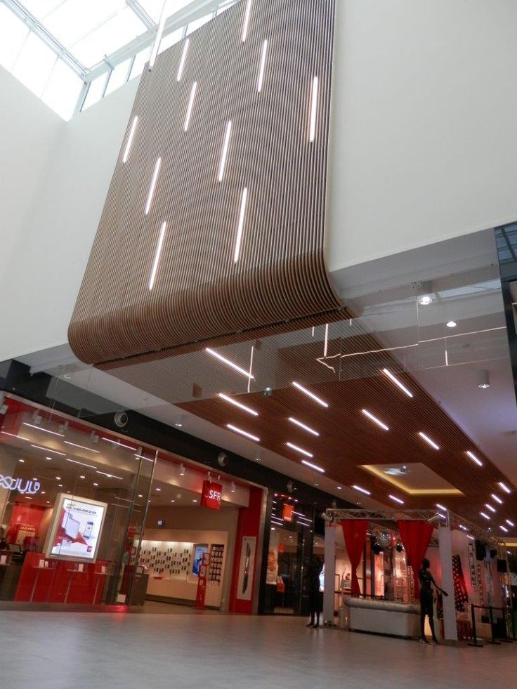 Increasing turnover in shopping malls through warm materials such as Laudescher timber ceilings.