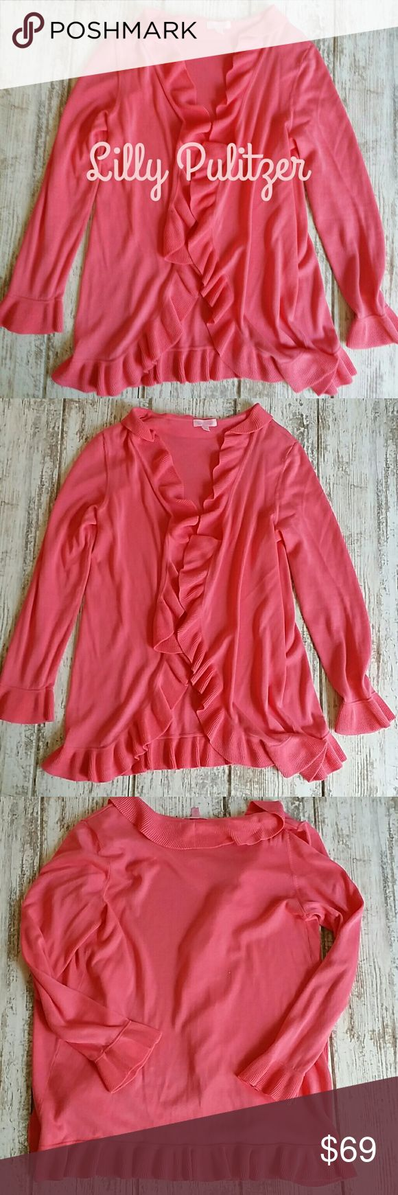"""Lilly Pulitzer cardigan *beautiful salmon/coral color  *100 % cotton   *hook and eye closures  *great condition   *Ruffled edge surrounds and on the cuffs  *about 30 """" from the shoulder to the hem   *sorry, no trades Lilly Pulitzer Sweaters Cardigans"""