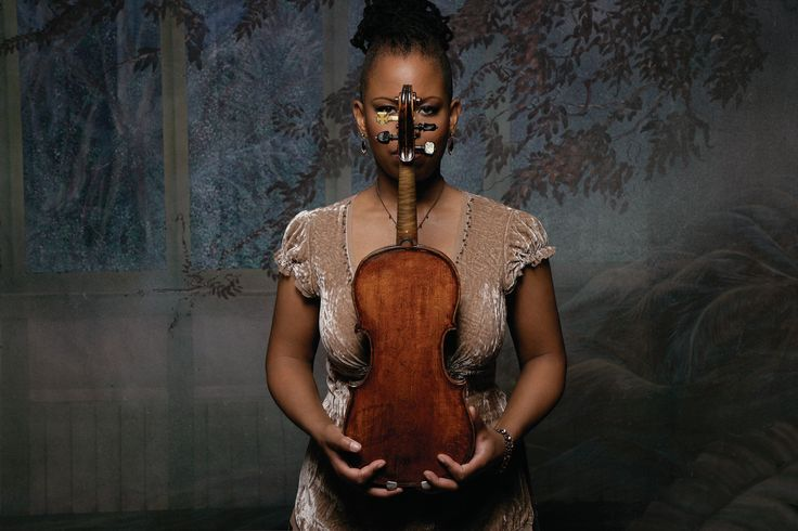 Regina Carter continues to have the same impeccable tone and technique, critical to sustain the mood of this kind of ensemble playing. Description from jazz.com. I searched for this on bing.com/images