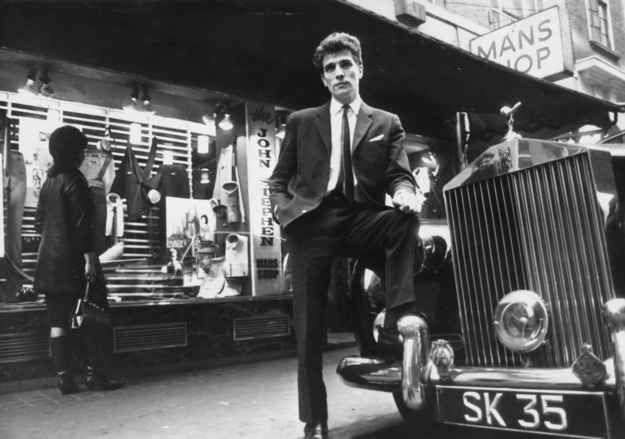 February 1964: Tailor John Stephen, with his Rolls Royce outside his shop.
