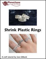 shrink plastic rings tutorial. Would look similar with resin and transparencies.
