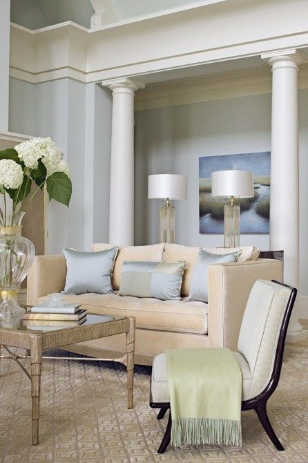 Pale blue living room walls with white columns and crown for Crown columns