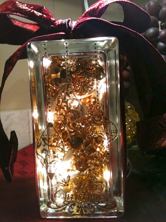 Merry Christmas Decorated Glass Block Light.  Vinyl scrapbooking stick-ons to front of glass block (Hobby Lobby).  20 count mini-lights and small gold tinsel (WalMart)   Tied a coordinating wired-edged bow on top.  Took about 30 minutes total.  DIY approx. costs $12.00