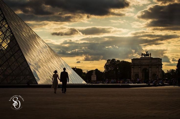Sunset at the #louvre. Paris is a dream destination for a #prewedding photo shoot. The #louvre was an amazing location with the #sunset behind the glass pyramid. This couple was a part of #aeuropeanlovestory artistic project during the European Summer of 2015.