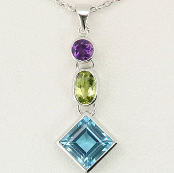 Check out this item in my Etsy shop https://www.etsy.com/au/listing/471063982/9k-white-gold-blue-topaz-amethyst