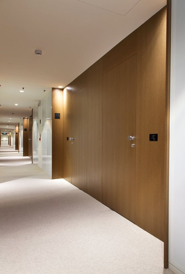 revestiment de paret integrant portes