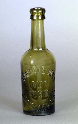 A late Victorian green Shrewsbury & Wem beer bottle with applied lip. Because of heavy taxation on both beer & glass, the sale of beer in bottles was not widespread until 19th century.