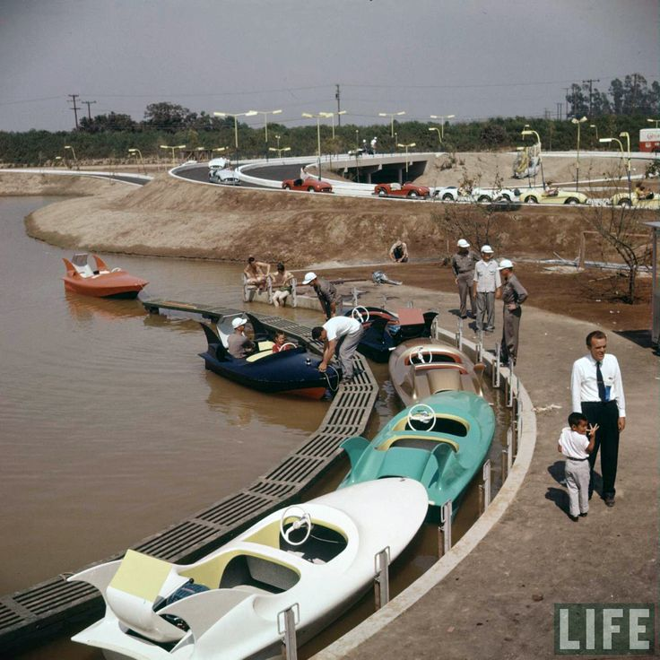 Disneyland opening day 1955 - Phantom Boats with Autopia in the background. From Life Magazine, photos by Allan Grant and Loomis Dean. Color corrected by United Style.