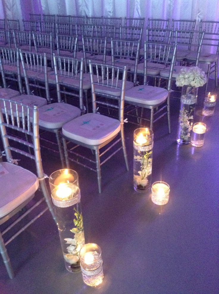Floating Candles And Flower Vase Decor For An Aisle During A Wedding Ceremony Heaveneventcenter