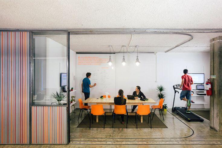 LIKEarchitects makes kinematix office adaptable with sliding garage doors