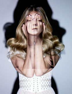 Projection mapping on the human body - female face through hands