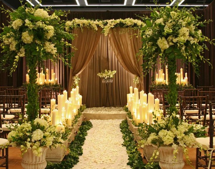outdoor wedding lighting decoration ideas. a dramatic indoor formal garden wedding with sheer brown flowing draping lush florals and tall outdoor lighting decoration ideas