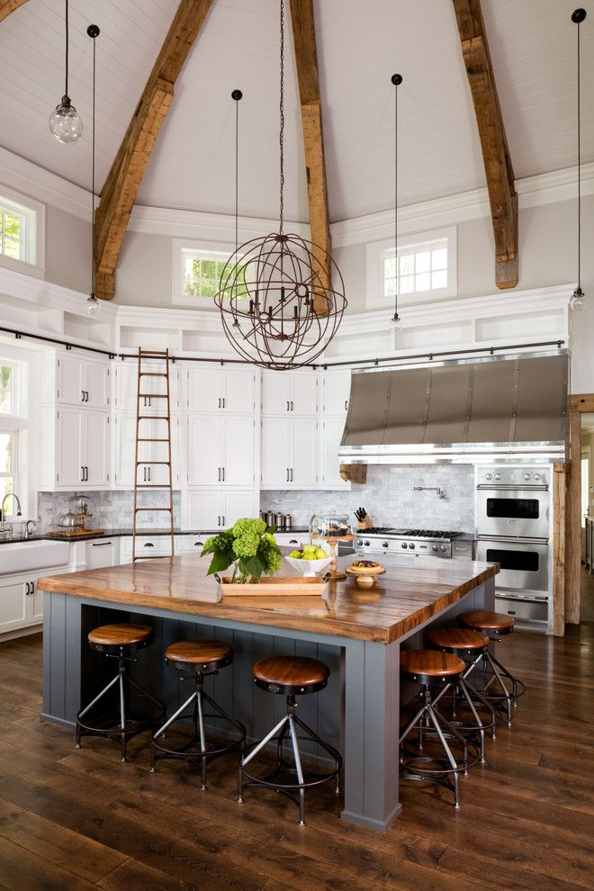 Farmhouse Kitchen Design - love this ginormous wood island with seating for 6 (love the floor color too & of course ceiling and beams + lighting)