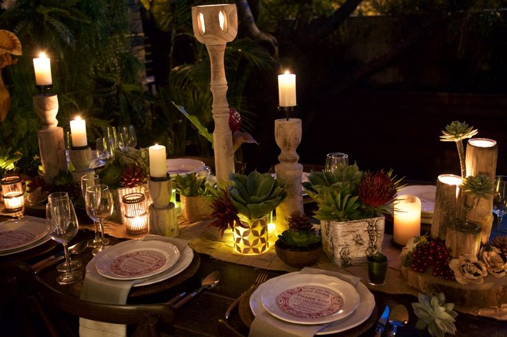 Rustic meets Polynesian table setting.  Artificial succulents, natural wood accessories, hessian and lots of candlelight.