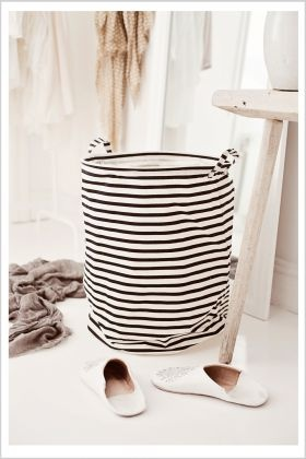 striped laundry bag by House Doctor - I got mine last week and it is perfekt: soft and light, but with enough stability to stand like this, even if empty.