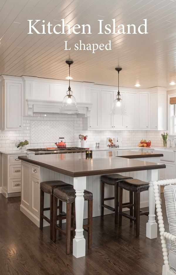 White Kitchen With An L Shaped Island Kitchenislands Whitekitchen Kitchen Island Shapes Kitchen Layout Kitchen Island With Seating