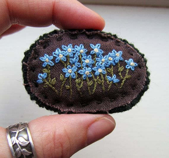 Forget Me Not Floral Embroidered Brooch  One of a kind    A bunch of sweet flowers all in a row, embroidered on hand dyed brown cotton, backed with