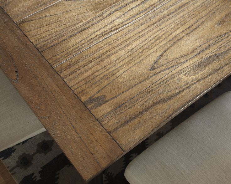 The Table Top Is Made With Boarder Framed Mindi Veneer In A Medium Rustic Brown Color