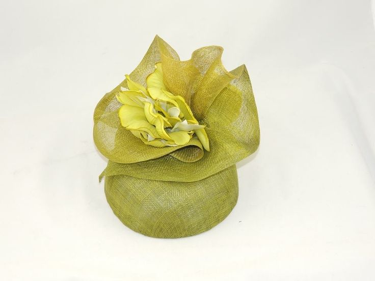 Spring green pillbox with sinamay swirl snd green/ivory flower detail to front and rear