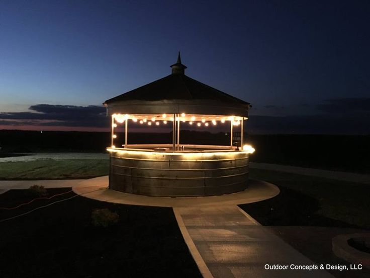 Grain bin bar a stunning outdoor living space completed for Pool design concepts llc