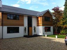 Cedar clad gable and upper floor, white render  Steele-Perkins - Self Build