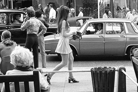 Girl in mini dress walking down the Kings Road, Chelsea. Photo: John Hendy