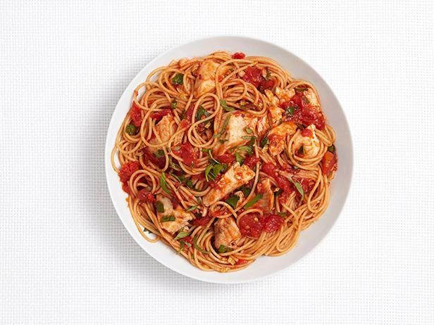 Garlic, herbs and red pepper flakes give the tomato sauce full flavor in this Spicy Pasta with Tilapia dish.