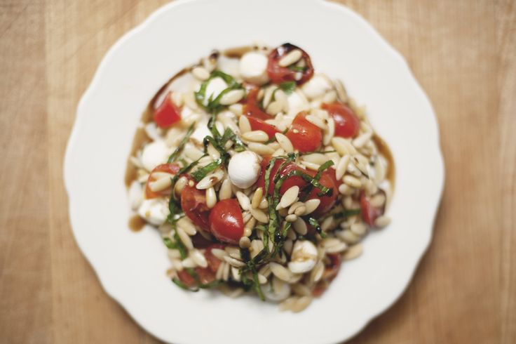 Balsamic Caprese Pasta Salad with Toasted pine nuts...I've made this one and it's DELICIOUS